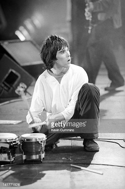 Singer Ian Brown performing with British rock group The Stone Roses at an outdoor concert at Spike Island Widnes Cheshire 27th May 1990