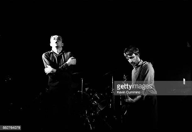Singer Ian Curtis and bassist Peter Hook performing with English rock group Joy Division, at the Russell Club, also known as The Factory, Manchester,...