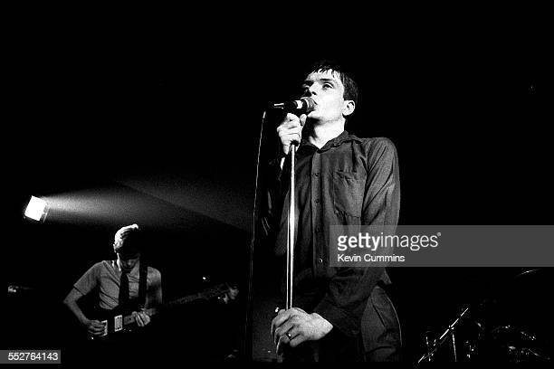 Singer Ian Curtis and guitarist Bernard Sumner performing with English rock group Joy Division at the Russell Club also known as The Factory...