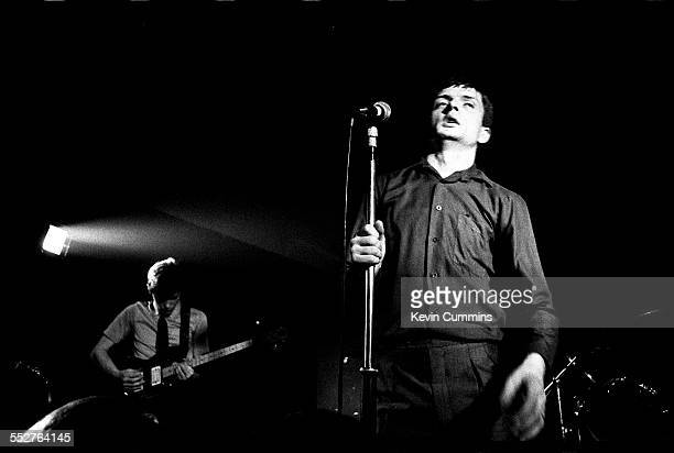 Singer Ian Curtis and guitarist Bernard Sumner performing with English rock group Joy Division, at the Russell Club, also known as The Factory,...