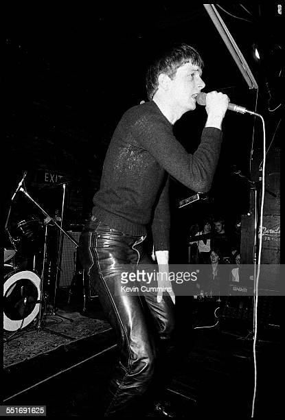 Singer Ian Curtis performing with English punk band Warsaw at Rafters nightclub in Oxford Street Manchester 30th June 1977 The band changed their...