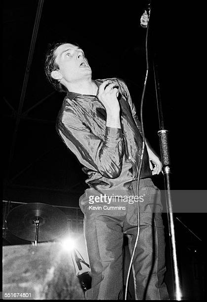 Singer Ian Curtis performing with English rock group Joy Division at the Futurama One Festival at the Queen's Hall Leeds 8th September 1979 The event...