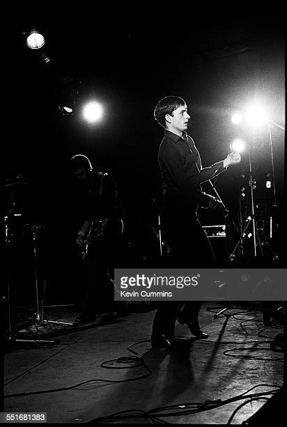 Singer Ian Curtis performing with rock group Joy Division at Leigh Open Air Festival, 27th August 1979. Bassist Peter Hook is on the left. The event...