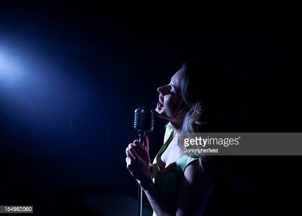 Singer in front of a spotlight