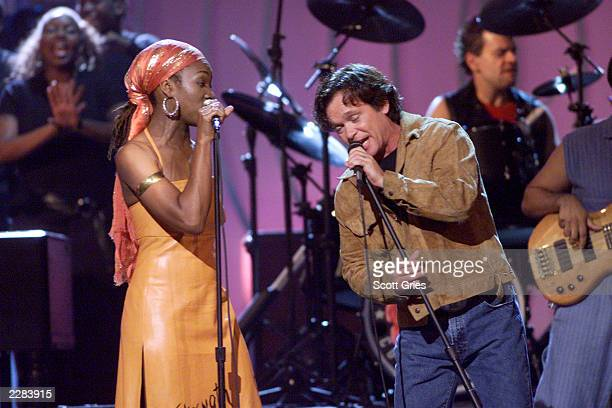 Singer India Arie performing with John Mellencamp at the 2001 VH1 Vogue Fashion Awards at Hammerstein Ballroom in New York City 10/19/01 Photo by...