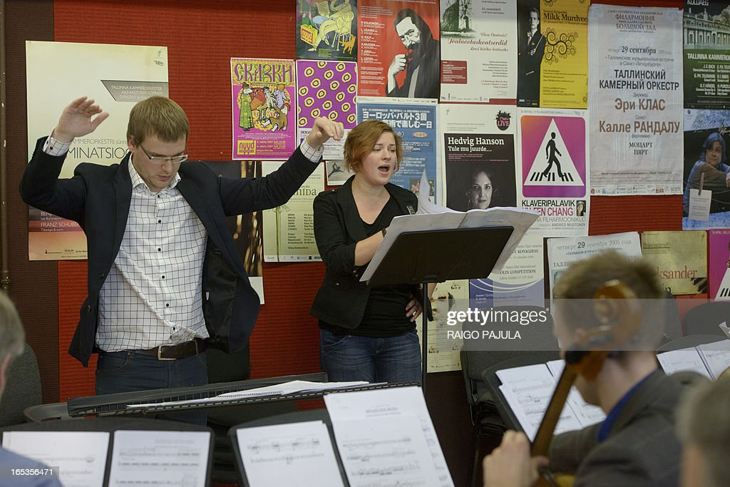 Singer Iris Oja (C) performs with members of the Tallinn Chamber Orchestra and their conductor Risto Joost (L) during a rehearsal of the opera 'Nostra Culpa' on April 3, 2013 in Tallinn, Estonia. US composer Eugene Birman turned into an opera a Twitter feud between the Estonian President Toomas Hendrik Ilves and New York Times columnist Paul Krugman who questioned the impact of Estonia's austerity measures. The short opera in two movements and using two voices will be first performed during Tallinn Music Week on April 7, Birman, who moved from Riga to the US at age of six, told AFP.