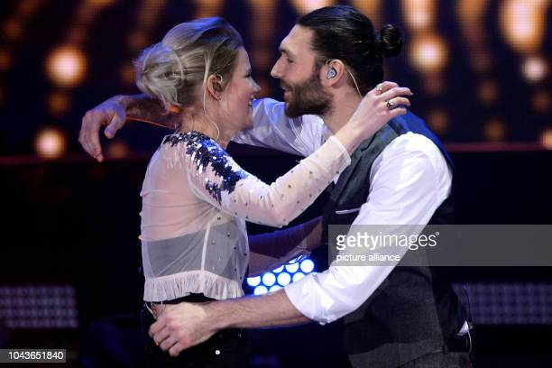 Singer Isabella 'Levina' Lueen celebrates her victory with competitor Axel Maximilian Feige during the German preliminary decision 'Unser Song fuer...