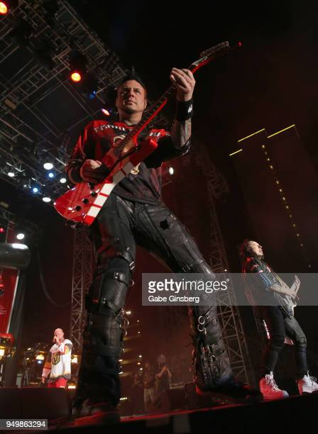 Singer Ivan Moody guitarists Jason Hook and Zoltan Bathory of Five Finger Death Punch perform during the Las Rageous music festival at the Downtown...