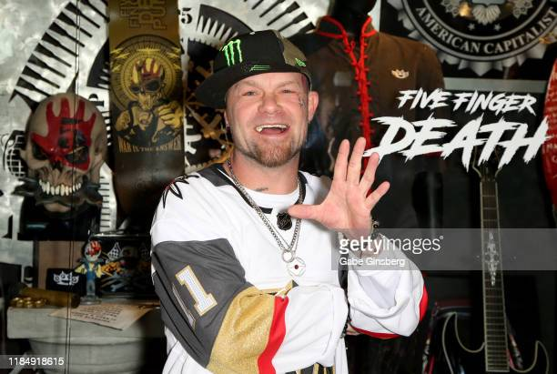 Singer Ivan Moody of Five Finger Death Punch attends a memorabilia case dedication ahead of the band's twonight Sin City Monster Bash and the start...