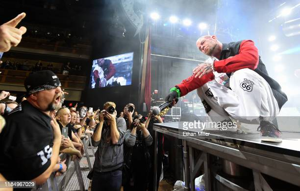 Singer Ivan Moody of Five Finger Death Punch holds his microphone out to fans as the band kicks off its fall 2019 tour at The Joint inside the Hard...