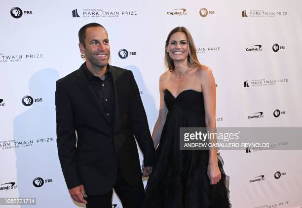 Singer Jack Johnson and his wife Kim pose on the red carpet for the 21st Annual Mark Twain Prize for American Humor at the Kennedy Center in...