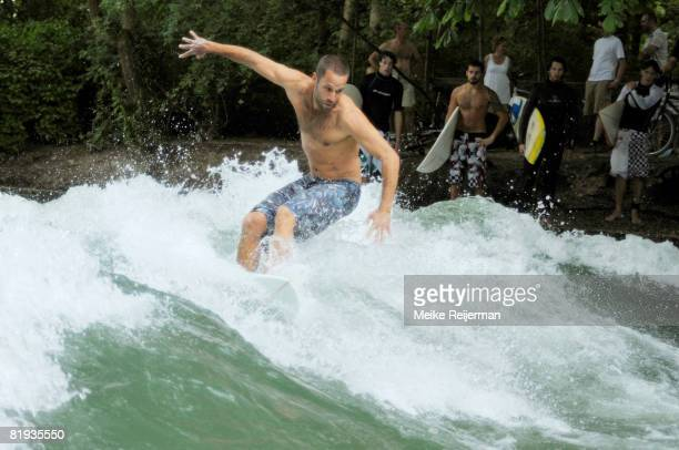 Singer Jack Johnson is seen surfing the famous 'Eisbach' near the discotheque P1 on July 11, 2008 in Munich, Germany. The hawaian singer and former...