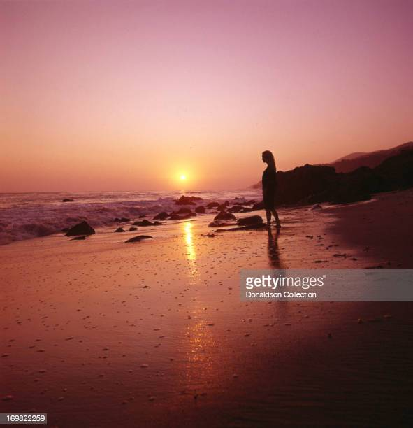 Singer Jackie DeShannon poses for a portrait session on the beach in circa 1964 in Los Angeles California