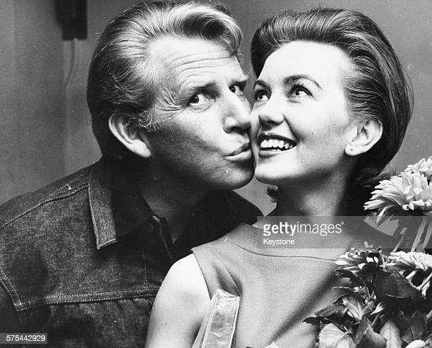 Singer Jackie Rae kissing his wife actress Janette Scott on the cheek on her birthday currently rehearing the pantomime 'Little Old King' at the...