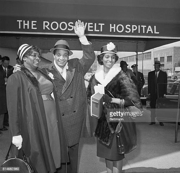 Singer Jackie Wilson waves as he leaves The Roosevelt Hospital with his mother Eliza Lee and his wife Freda Wilson was shot and seriously wounded by...