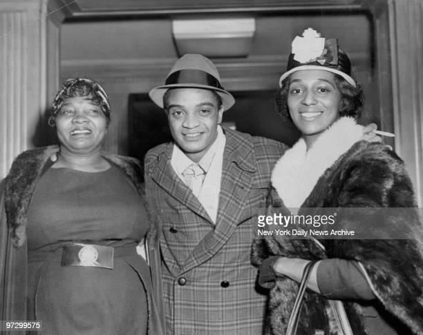 Singer Jackie Wilson with mother Eliza Lee and wife Freda outside Roosevelt Hospital after a fan Juanita Jones shot him twice