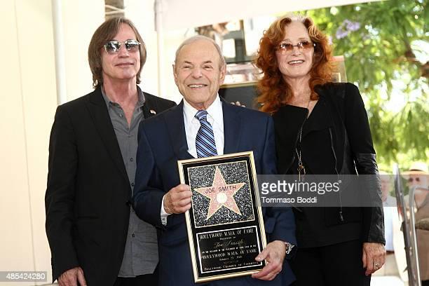 Singer Jackson Browne music executive Joe Smith and singer Bonnie Raitt attend a ceremony honoring music executive Joe Smith wtih a star on The...