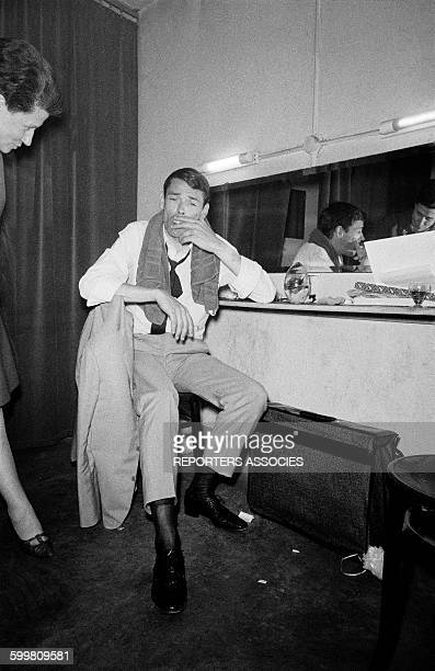 Singer Jacques Brel in his dressingroom at the théâtre des Variétés in Paris France in 1960