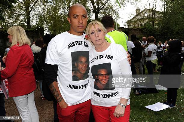 Singer Jade Jones and his mother Rita KennedyJones prepare to march through East London with famly and supporters on April 26 2014 in London England...