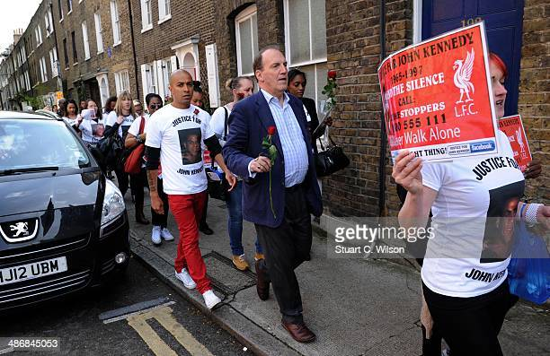 Singer Jade Jones and Simon Hughes MP march through East London with famly and supporters on April 26 2014 in London England They are marching to...