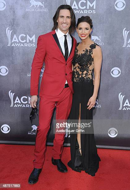 Singer Jake Owen and wife Lacey Buchanan arrive at the 49th Annual Academy of Country Music Awards at the MGM Grand Hotel and Casino on April 6 2014...