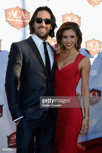 Singer Jake Owen and wife Lacey Buchanan arrive at the American Country Awards 2013 at the Mandalay Bay Events Center on December 10, 2013 in Las...