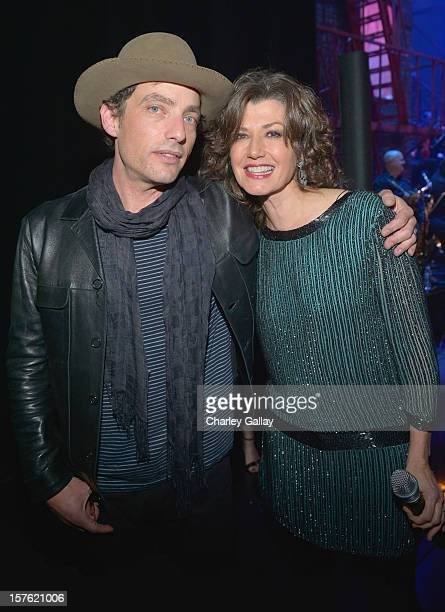 Singer Jakob Dylan and singer Amy Grant attend a celebration of Carole King and her music to benefit Paul Newman's The Painted Turtle Camp at the...