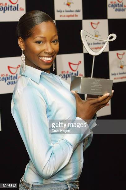 """Singer Jamelia with her award for Favourite UK Single for 'Superstar' in the awards room at the """"Capital FM Awards 2004"""" at the Royal Lancaster Hotel..."""