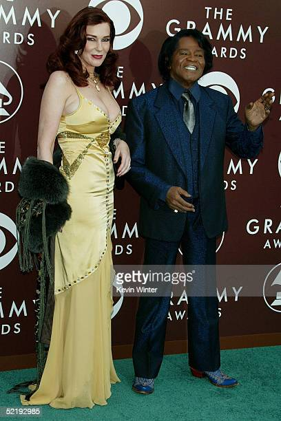 Singer James Brown and his wife Tommie Rae arrive to the 47th Annual Grammy Awards at the Staples Center February 13 2005 in Los Angeles California