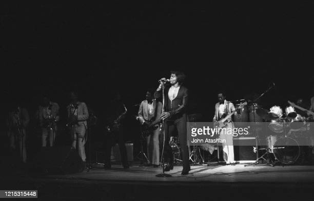 Singer James Brown is shown performing on stage during a live concert appearance on September 20 1985