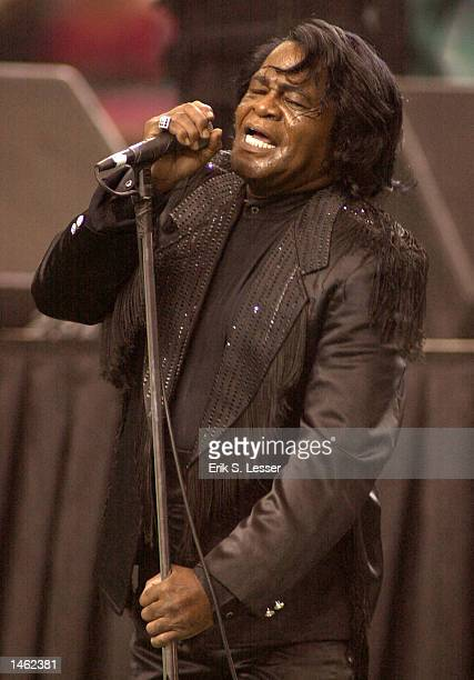 Singer James Brown performs at the conclusion of the Atlanta Falcons vs. Tampa Bay Buccaneers football game on October 6, 2002 at the Georgia Dome in...