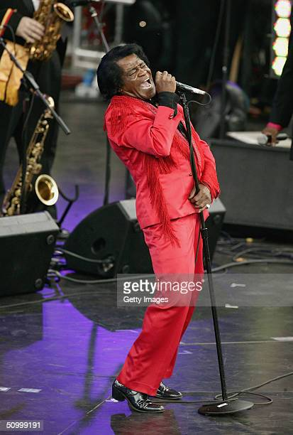 Singer James Brown performs on stage at the Olympic Torch Concert held in The Mall on June 26 2004 in London The free concert organised by Visit...