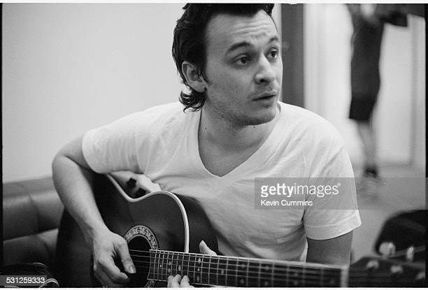 Singer James Dean Bradfield of Welsh alternative rock group the Manic Street Preachers playing a guitar backstage Bangkok Thailand 27th April 1994