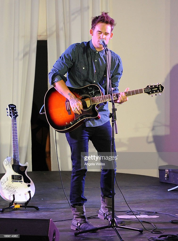 Singer James Durbin performs at Autism Speaks' 3rd Annual 'Blue Jean Ball' presented by The GUESS Foundation at Boulevard 3 on October 24, 2013 in Hollywood, California.