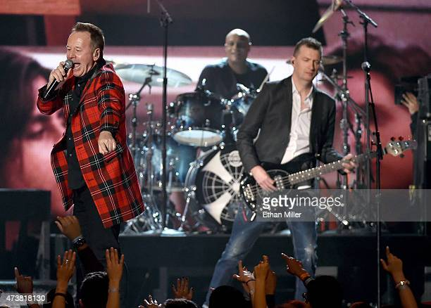 Singer James Kerr drummer Mel Gaynor and bassist Ged Grimes of Simple Minds perform onstage during the 2015 Billboard Music Awards at MGM Grand...