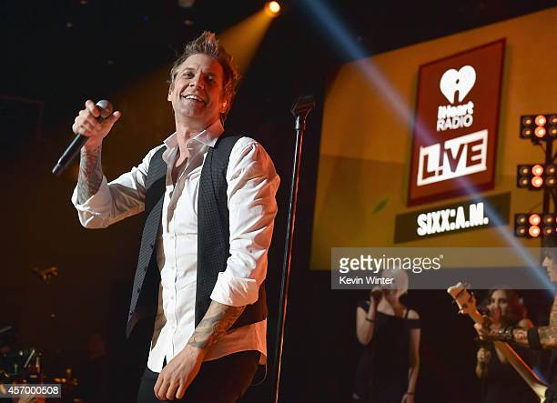 Singer James Michael of Sixx AM performs for iHeartRadio Live at The iHeartRadio Theater Los Angeles on October 7 2014 in Burbank California