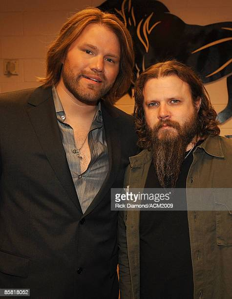 Singer James Otto and musician Jamey Johnson pose backstage during the 44th annual Academy Of Country Music Awards held at the MGM Grand on April 5...