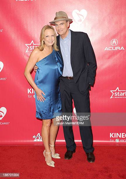 Singer James Taylor and Kim Smedvig arrive at the 2012 MusiCares Person of the Year Tribute To Paul McCartney held at the Los Angeles Convention...