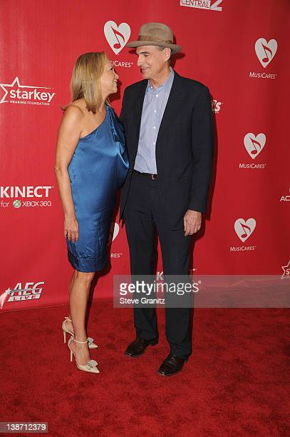 Singer James Taylor and Kim Smedvig arrive at The 2012 MusiCares Person of The Year Gala Honoring Paul McCartney at Los Angeles Convention Center on...