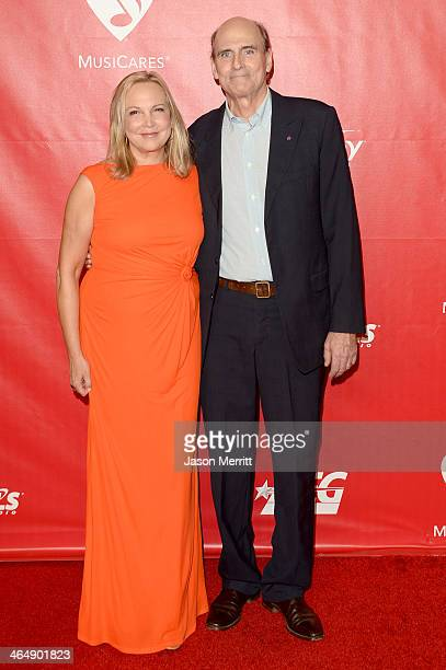 Singer James Taylor and Kim Taylor attend The 2014 MusiCares Person Of The Year Gala Honoring Carole King at Los Angeles Convention Center on January...