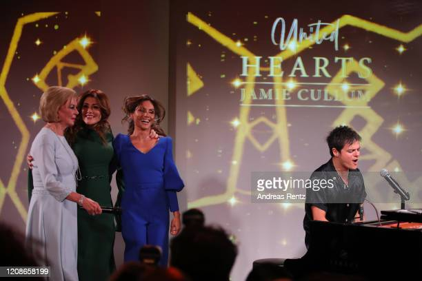 Singer Jamie Cullum performs on stage while Liz Mohn, Sedef Ayguen and Nazan Eckes dance during the Titanic United Hearts at Titanic Hotel on...