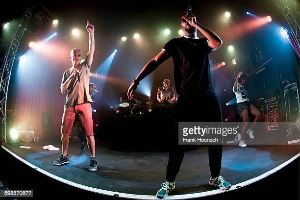 Singer Jan Delay, DJ Mad and Denyo of the German band Beginner perform live during a concert at the Lido on August 24, 2016 in Berlin, Germany.