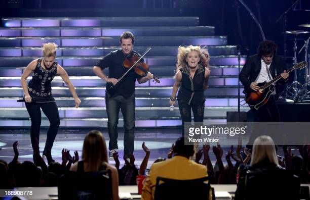Singer Janelle Arthur performs onstage with Musicians Neil Perry Kimberly Perry and Reid Perry of The Band Perry during Fox's American Idol 2013...