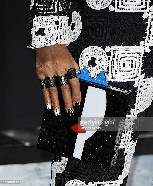 "Singer Janelle Monae, handbag, jewelry and nail detail, attend the premiere of ""Creed"" at Regency Village Theatre on November 19, 2015 in Westwood,..."