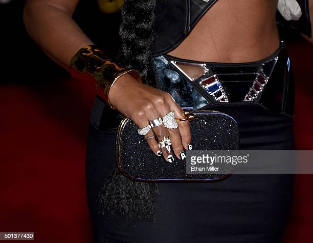 Singer Janelle Monae jewelry and handbag detail attends the Premiere of Walt Disney Pictures and Lucasfilm's 'Star Wars The Force Awakens' at the...