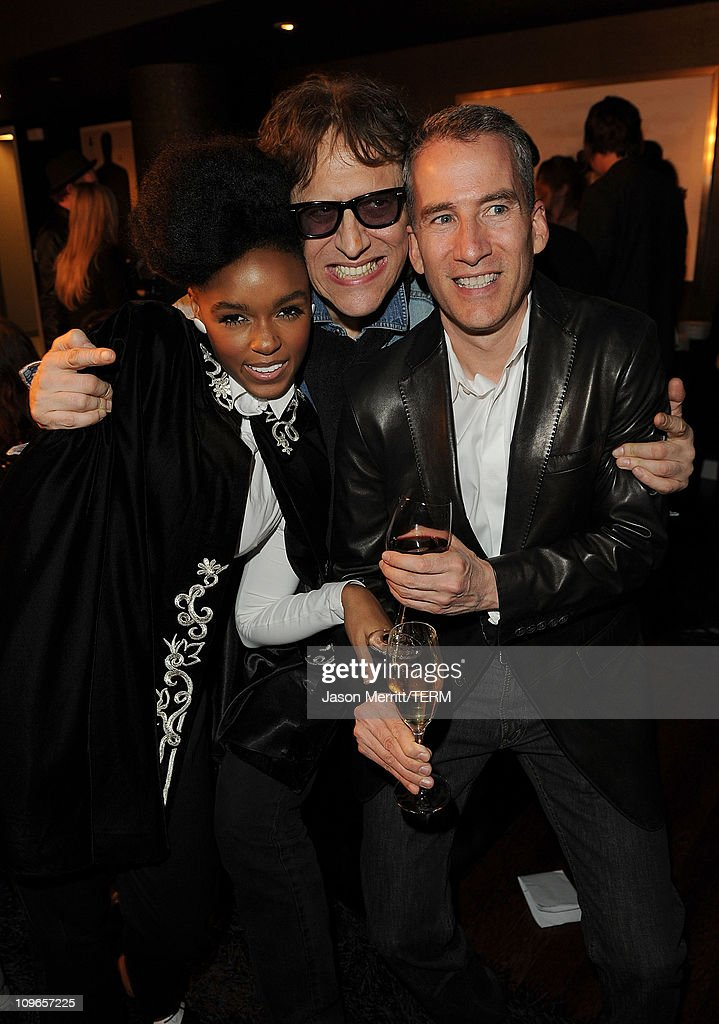 Singer Janelle Monae, photographer Mick Rock, and general manager Jim Mc Parlin pose at W Hotels' Symmetry Live featuring Janelle Monae at W Hollywood on May 25, 2010 in Hollywood, California.