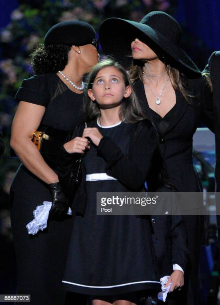 Singer Janet Jackson Paris Jackson and La Toya Jackson appear onstage at the Michael Jackson public memorial service held at Staples Center on July 7...