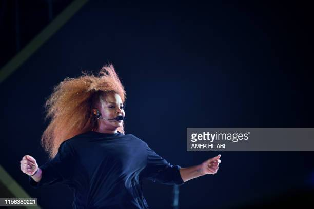 US singer Janet Jackson performs on stage during the Jeddah World music Festival late on July 18 at the King Abdullah Sports City in the coastal city...