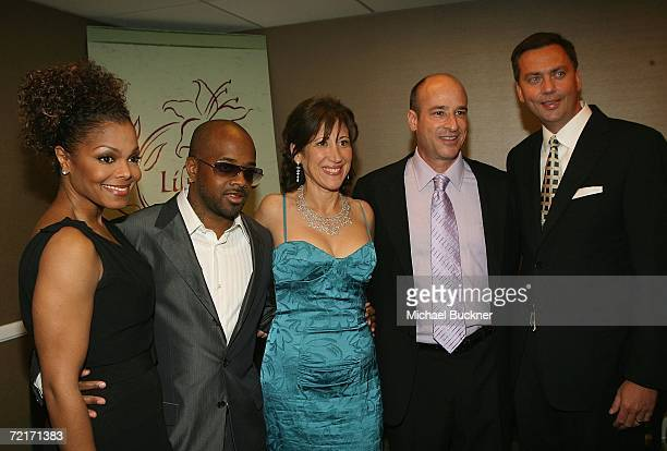 Singer Janet Jackson rapper Jermaine Dupri Leslie Litt Keith Resnick and Chris Howard of Chrysler Financial pose backstage at the 9th Annual Dinner...