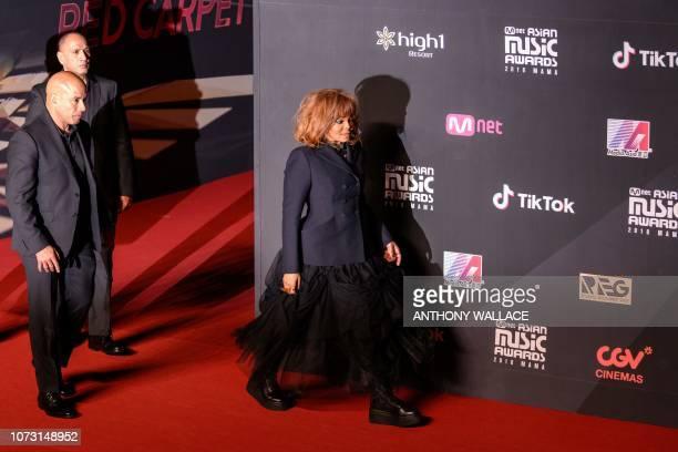 US singer Janet Jackson walks onto the red carpet at the Mnet Asian Music Awards in Hong Kong on December 14 2018